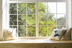Bright photo studio interior with big window, high ceiling, wood